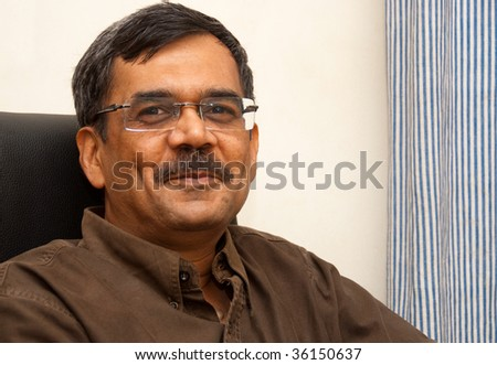 A portrait of a smiling Indian man - stock photo