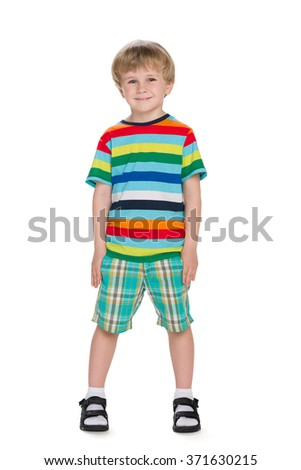 A portrait of a smiling little boy in a striped shirt - stock photo