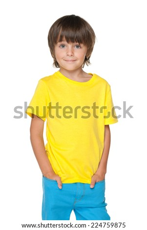 A portrait of a smiling little boy in a yellow shirt against the white background - stock photo