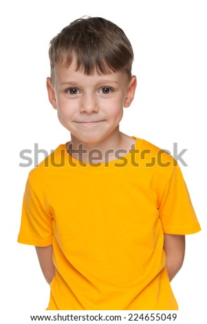 A portrait of a smiling little boy in a yellow shirt on the white background - stock photo