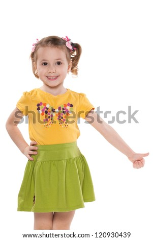 A portrait of a smiling little girl holding her thumb up; isolated on the white background - stock photo
