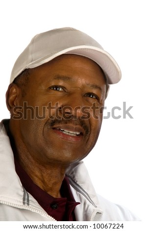 A portrait of a smiling, middle-aged black golfer. - stock photo