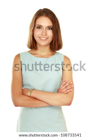 A portrait of a smiling young woman standing isolated on white background