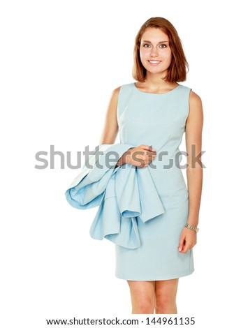 A portrait of a smiling young woman standing isolated on white background - stock photo