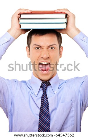 A portrait of a stressed young student holding book over his head isolated on white background - stock photo