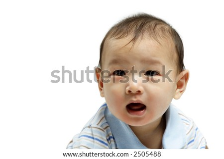 A portrait of a surprised baby boy - stock photo