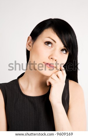 A portrait of a thinking beautiful businesswoman - stock photo