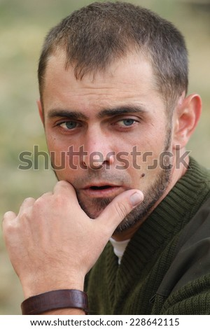 A portrait of a thinking man - stock photo