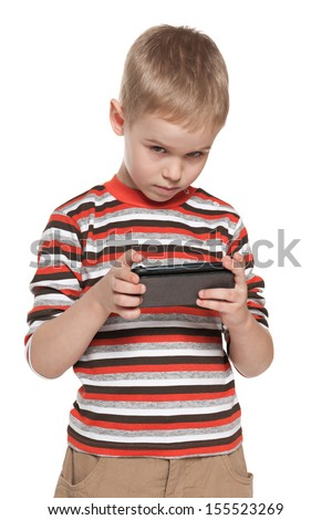 A portrait of a thoughtful boy with a gadget - stock photo