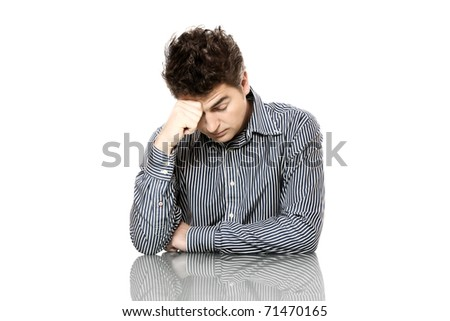 A portrait of a tired businessman leaning on his arm over white background