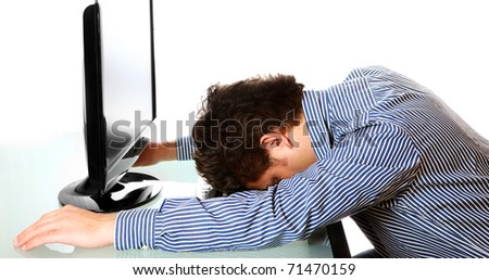 A portrait of a tired businessman resting his head on the keyboard over white background