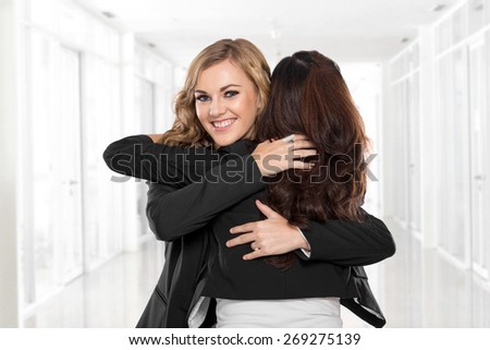 A portrait of a two young businesswoman have a reconciliation - stock photo