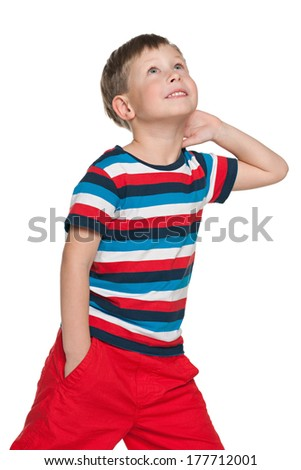 A portrait of a walking smiling boy on the white background - stock photo