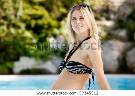 A portrait of a woman enjoying the outdoors at a pool - stock photo