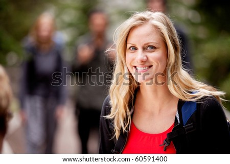 A portrait of a woman outdoors in the forest - stock photo