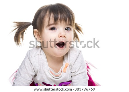 A Portrait of a 2 year old girl isolated on white background - stock photo