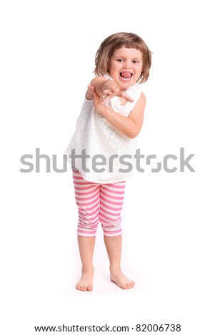 A portrait of a young adorable girl trying to reach something over white background - stock photo