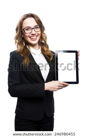 a portrait of a young attractive woman holding a tablet computer - stock photo