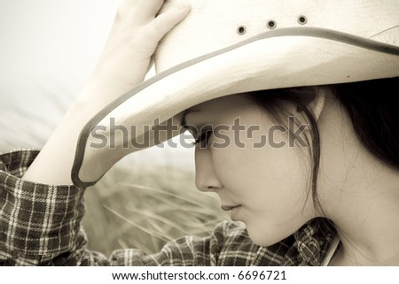 A portrait of a young beautiful girl posing outdoor - stock photo