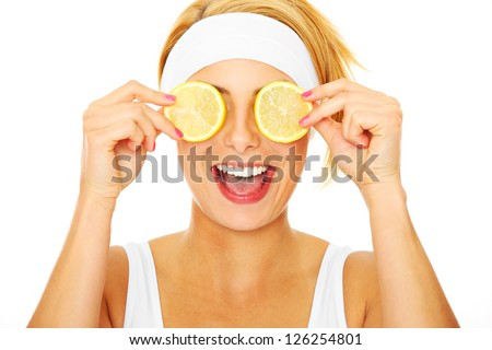 A portrait of a young beautiful woman with lemon over white background - stock photo