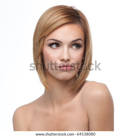 a portrait of a young, blonde woman, looking to the right, with a suspicious expression on her face - stock photo