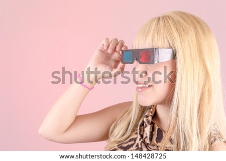 a portrait of a young, blonde woman, smiling with 3d glasses - stock photo