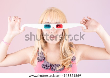 a portrait of a young, blonde woman, with 3d glasses