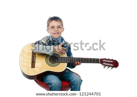 A portrait of a young boy playing guitar, isolated on white background - stock photo