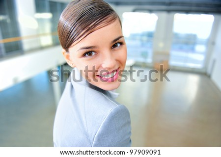 A portrait of a young business woman in a new office - stock photo