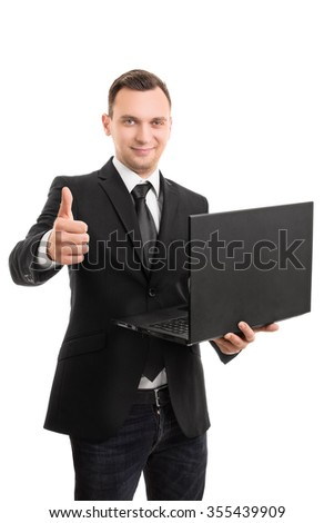 A portrait of a young businessman holding a laptop giving a thumbs up, isolated on white background.