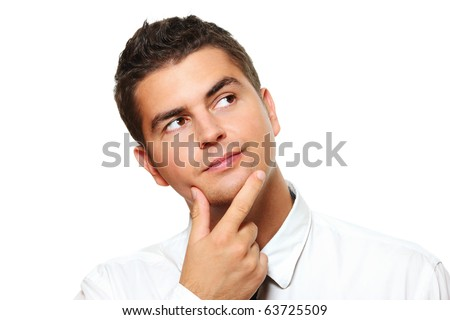 A portrait of a young businessman lost in thoughts over white background - stock photo