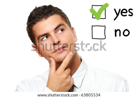 A portrait of a young businessman voting for yes over white background