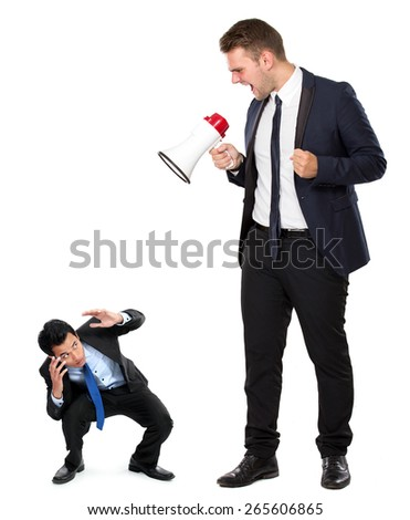 A portrait of a young businessman with a megaphone - stock photo