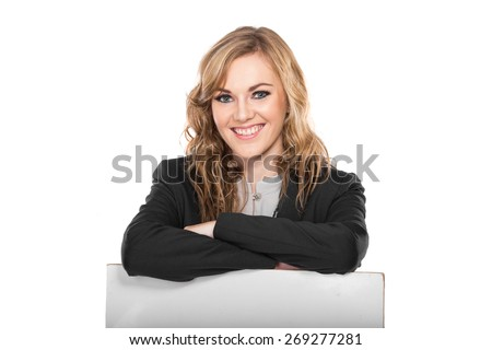 A portrait of a young Businesswoman smiling while holding blank sign isolated on white background - stock photo