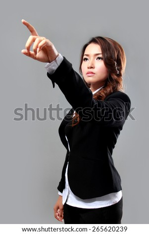 A portrait of a young businesswoman touching a screen to presenting a presentation - stock photo