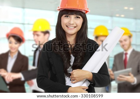 A portrait of a young businesswoman wear a safety helmet - stock photo
