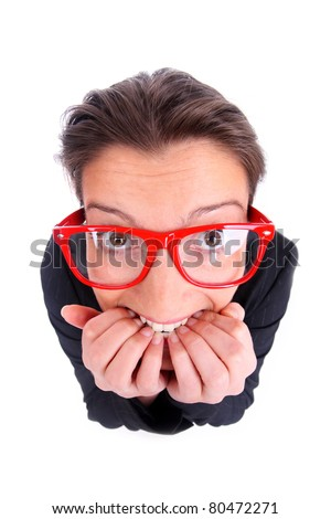 A portrait of a young frustrated woman biting her nails over white background