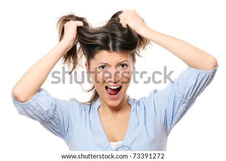 A portrait of a young frustrated woman pulling out hair over white background - stock photo