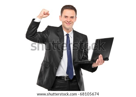 A portrait of a young happy businessman holding a laptop isolated on white background