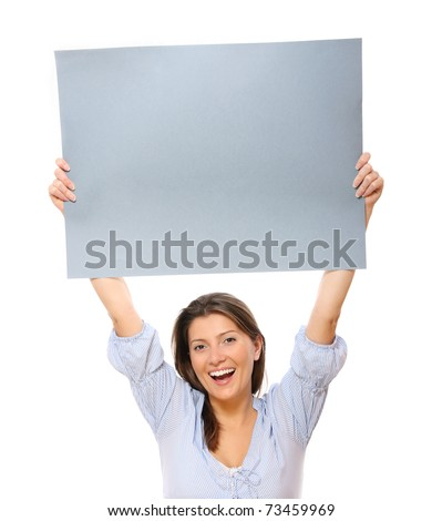 A portrait of a young happy woman holding a banner over white background - stock photo