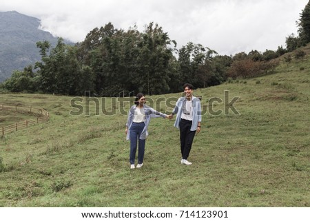 A portrait of a young man and woman couple have fun, enjoy holiday, happy life, love at mountain. Pre-wedding concept.