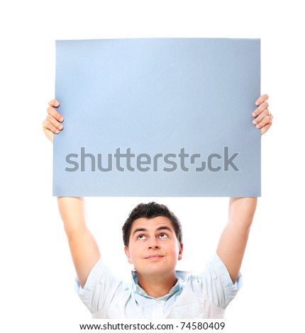 A portrait of a young man holding a banner over white background - stock photo