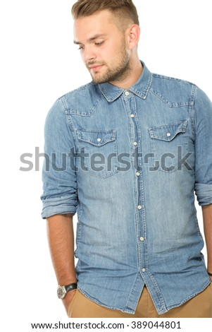 A portrait of a Young man posing casualy, isolated - stock photo