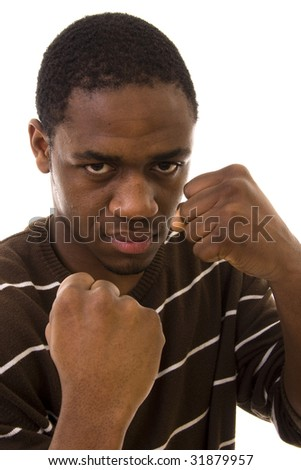 A portrait of a young man ready to fight - stock photo