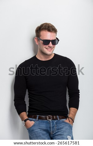 A portrait of a young man smile with sunglasses on