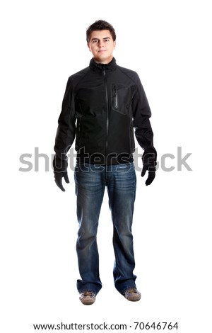 A portrait of a young trendy man standing against white background