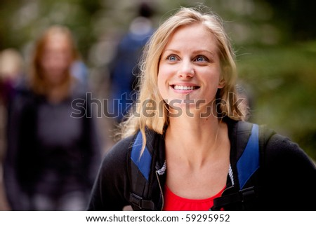 A portrait of a young woman enjoying the outdoors