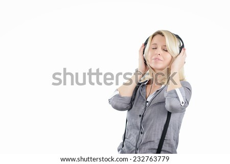 A portrait of a young woman in headset listening to the music - stock photo