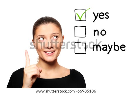 A portrait of a young woman voting for yes over white background - stock photo