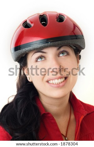 A portrait of a young woman with a bicycle safety helmet, looking up. - See more in portfolio
